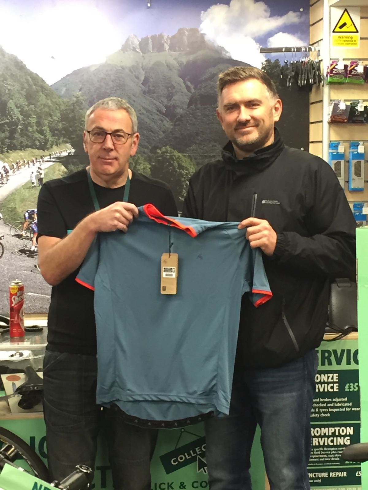 Dave presenting Nigel with the groups sponsored jerseys